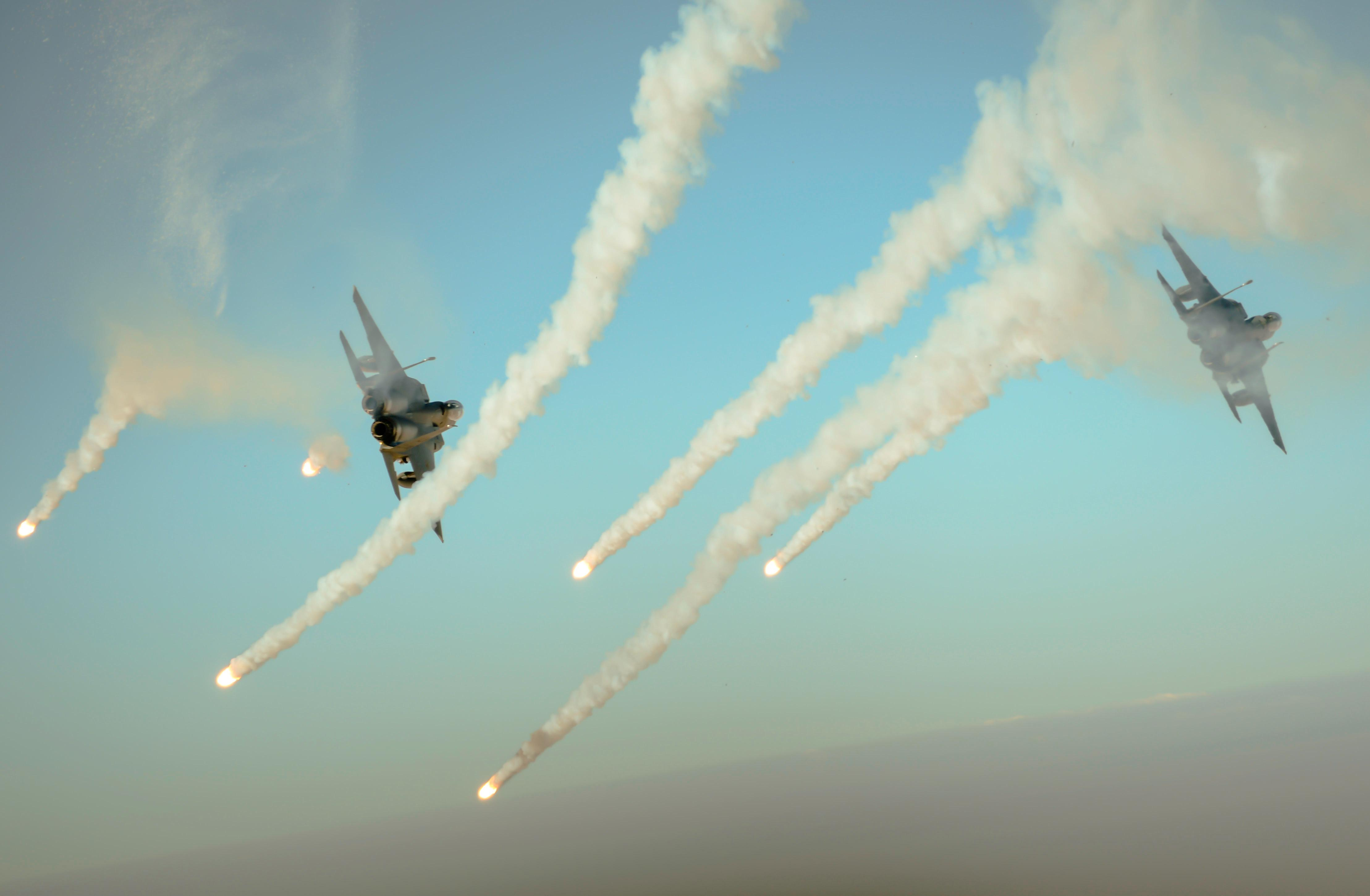 Two F-15E Strike Eagles fire flares over Iraq during a mission in support of Operation Inherent Resolve, on Sept. 6, 2017. The F-15E Strike Eagle is a dual-role fighter designed to perform air-to-air and air-to-ground missions. An array of avionics and electronics systems give the F-15E the capability to fight at low altitude, day or night, and in all weather conditions. (U.S. Air Force photo by Staff Sgt. Trevor T. McBride)