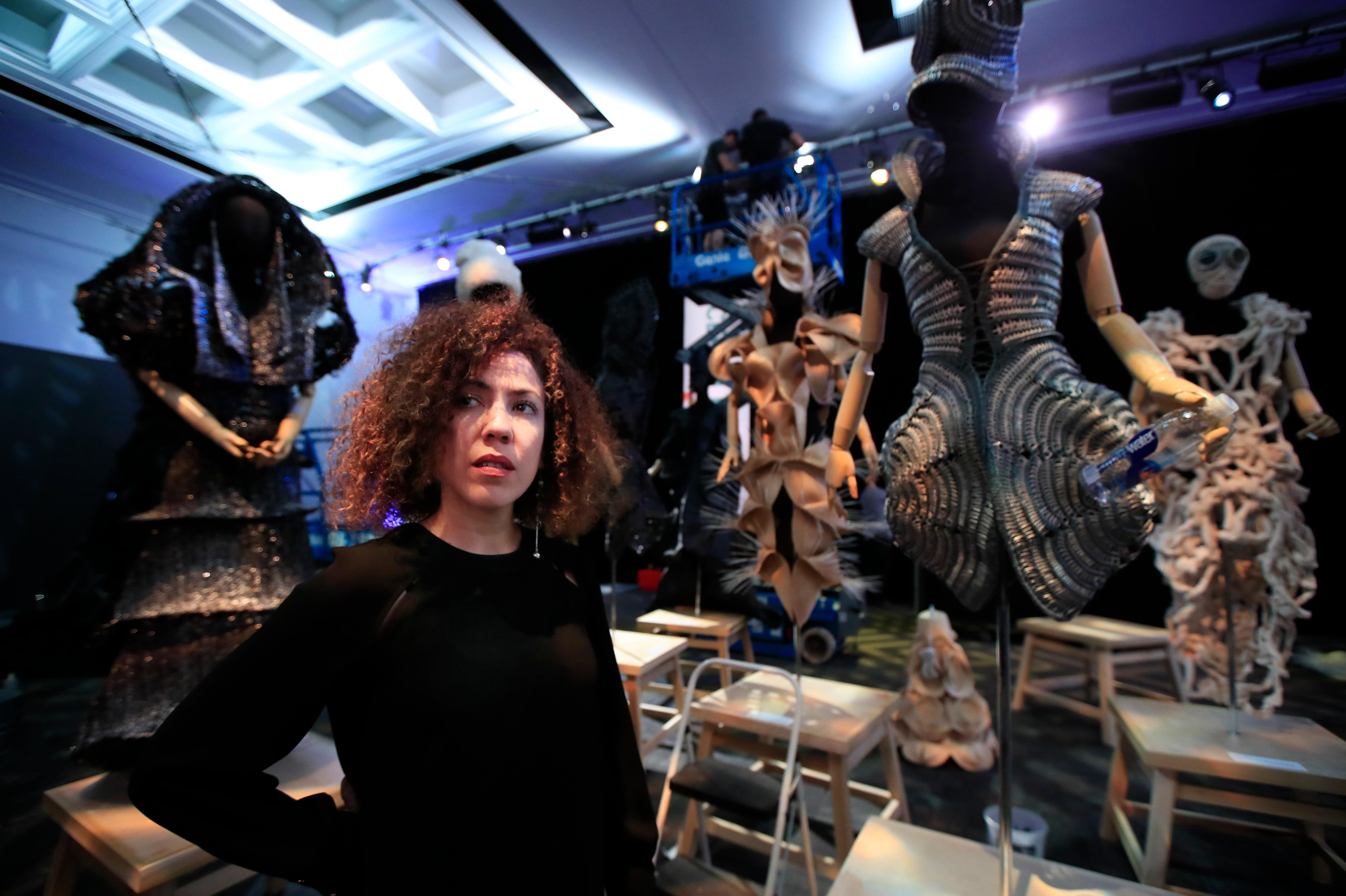 Cuban designer Celia Ledón poses with her fashion creation at the Kennedy Center in Washington, Tuesday, May 8, 2018. Renewed tensions between the U.S. and Cuba did not stop the John F. Kennedy Center for the Performing Arts from shining a spotlight on the island's rich cultural heritage during what's being billed as the largest Cuban arts festival ever held in the United States.  (AP Photo/Manuel Balce Ceneta)