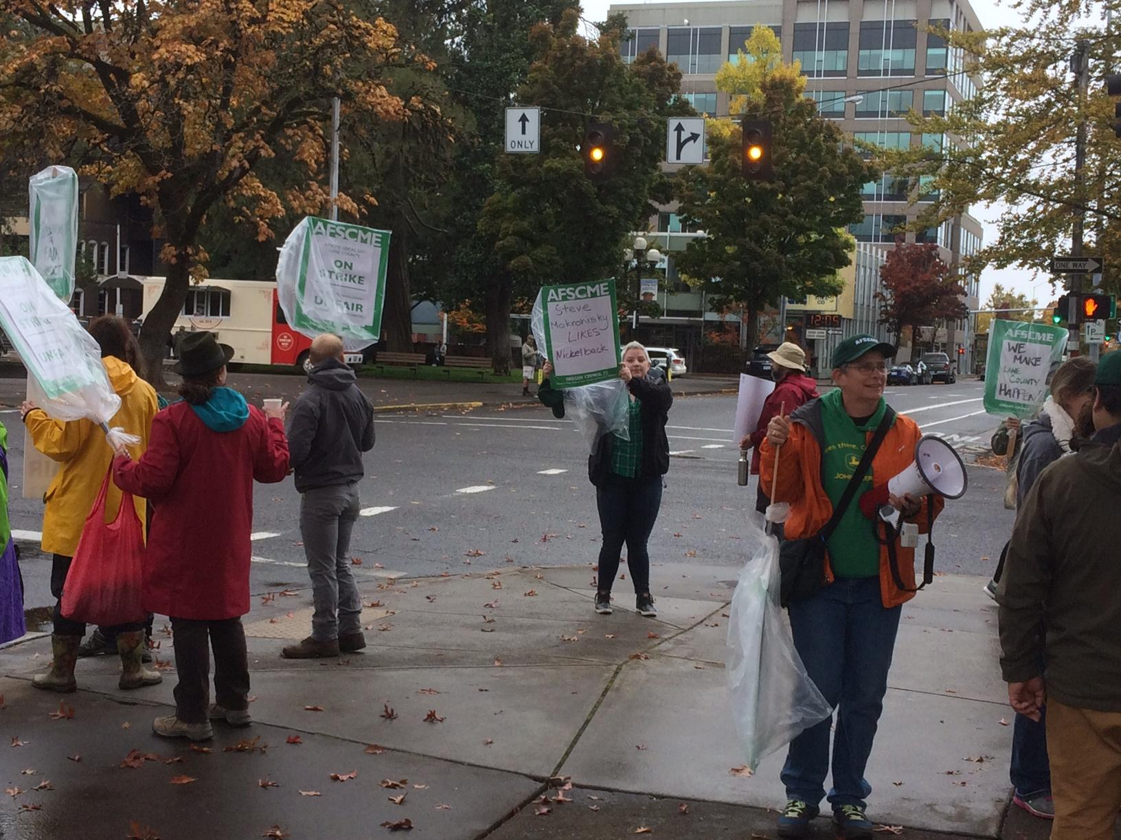 Lane County employees represented by AFSCME returned to the picket lines Thursday after going on strike Wednesday morning. The county and union return to the negotiating table on Friday. (SBG)