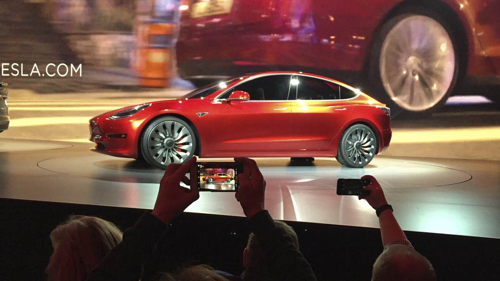 On The Road To Make An Affordable Car Tesla Cuts Jobs Wstm