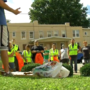 Church groups and first responders clean up west Huntington streets and alleys