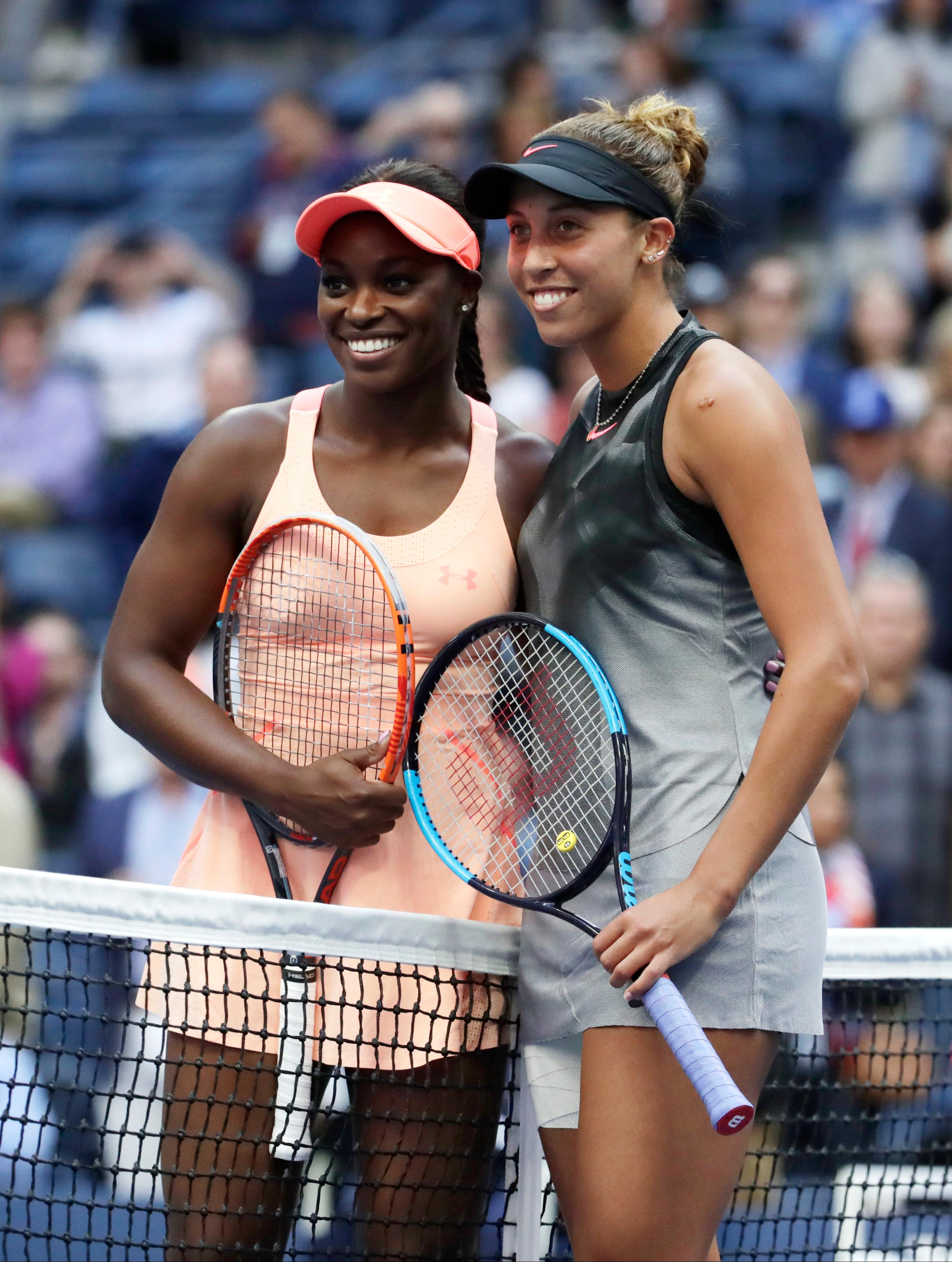 Sloane Stephens, of the United States, left and Madison Keys, of the United States, stand at the net for a photo before playing each other in the championship match of the U.S. Open tennis tournament, Saturday, Sept. 9, 2017, in New York. (AP Photo/Julio Cortez)