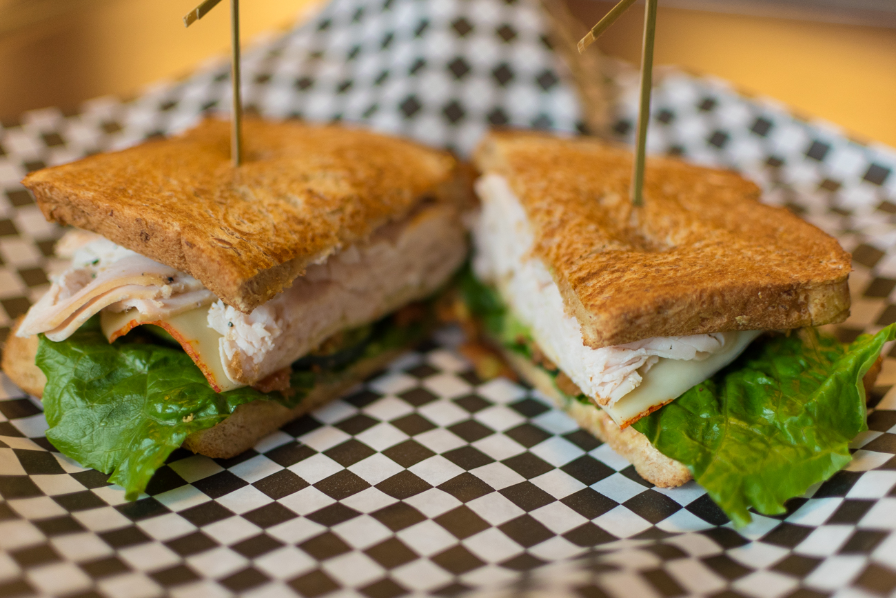 Turkey Club: applewood bacon, avocado, honey mustard, muenster cheese, and cucumber lettuce / Image: Phil Armstrong, Cincinnati Refined / Published: 1.1.17