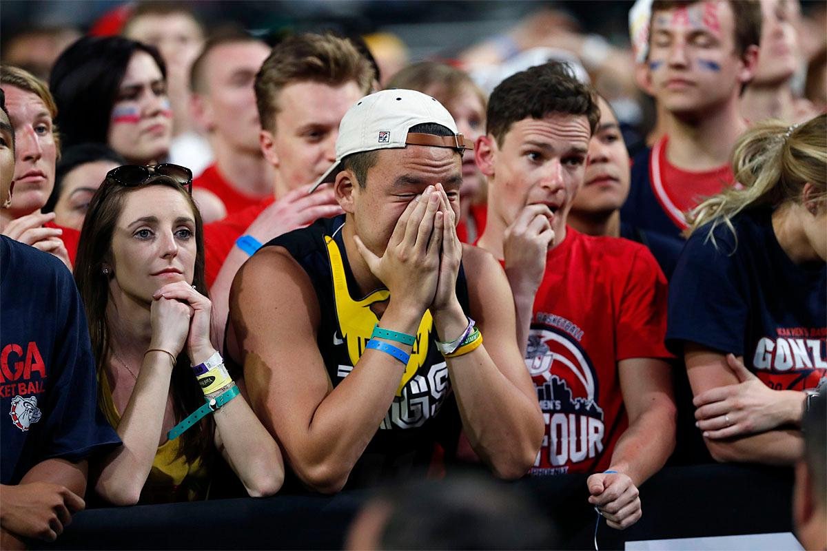 Gonzaga fans react at the end of the championship game against North Carolina at the Final Four NCAA college basketball tournament, Monday, April 3, 2017, in Glendale, Ariz. North Carolina 71-65. (AP Photo/Charlie Neibergall)