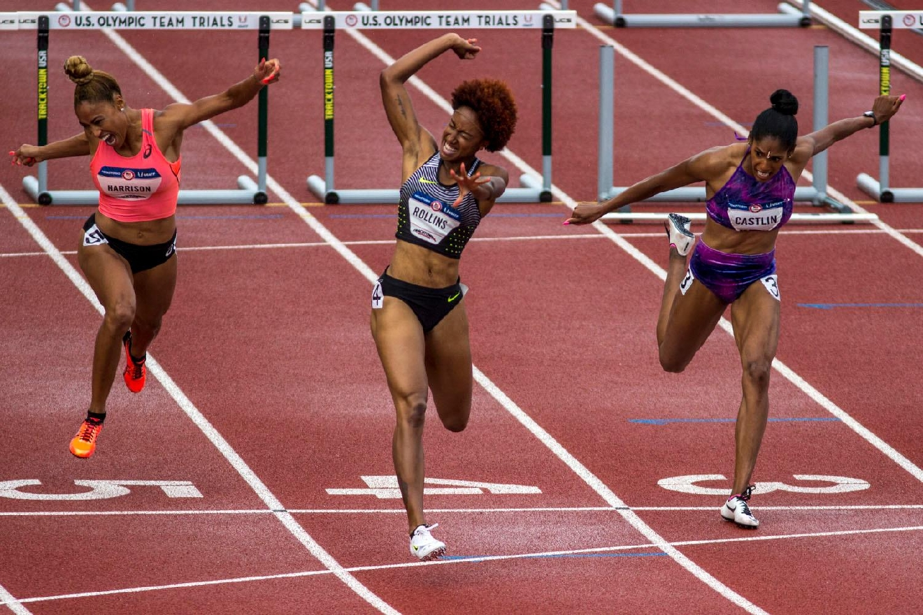 From left to right, Queen Harrison, Brianna Rollins, and Kristi Castlin cross the finish line in the Women�s 100m Hurdle final. Harrison finished fourth with a time of 12.57. Rollins finished first with a time of 12.34. Castlin finished second with a time of 12.50. Kristi Castlin, left, and Nia Ali, right, embrace after realizing they qualified for the Rio Olympics in the Women�s 100m Hurdle. Castlin finished second with a time of 12.50. Ali finished third with a time of 12:55. Day eight of the U.S. Olympic Track and Field Trials took place Friday at Hayward Field in Eugene, Ore. Events continue through July 10. (Photo by Amanda Butt)