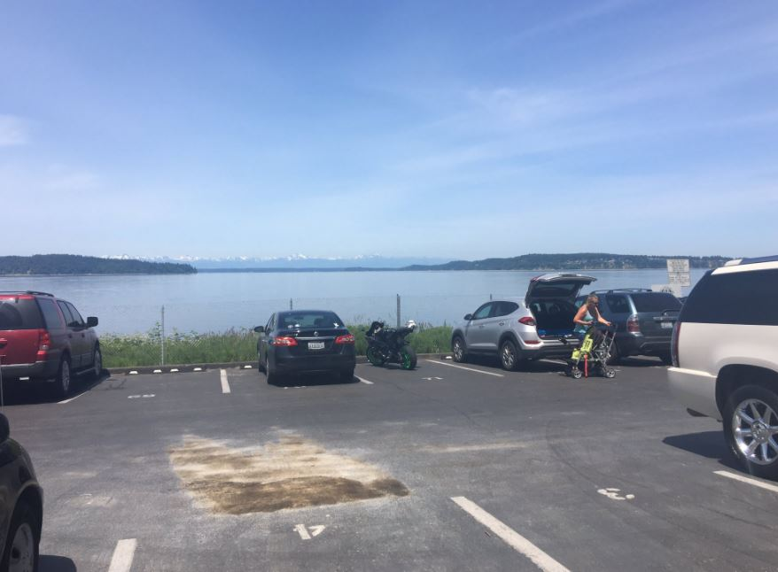Shannon MacLeod was killed Monday after her van rolled over her across the street from this parking lot at Sunnyside Beach Park. (Photo: KOMO News)