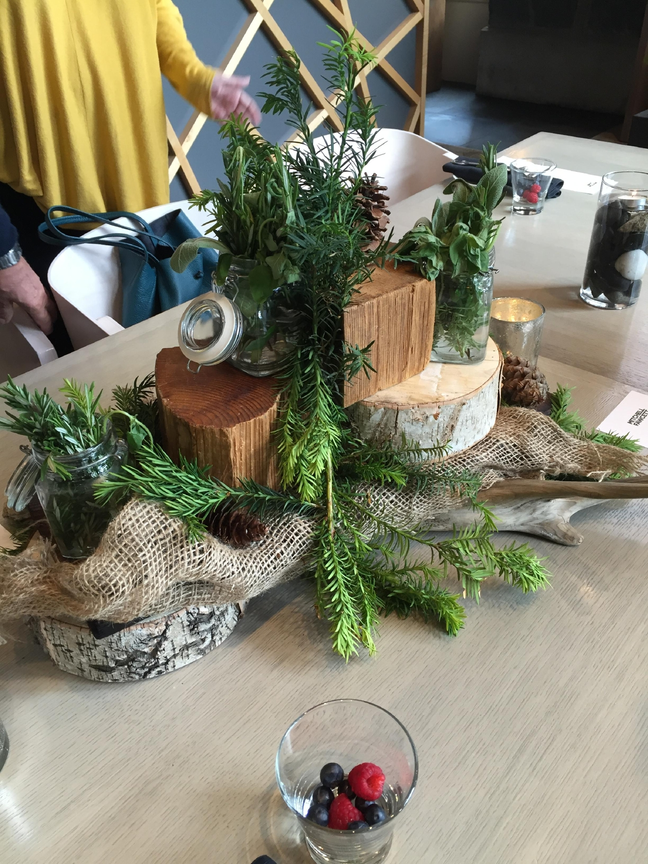 "I could not get over the centerpiece at dinner. Someone flippantly said how easy it was, ""Just throw some wood and branches together"" - but I guarantee you if I tried it would look like a bonfire on my table. (Image: Britt Thorson / Seattle Refined)"