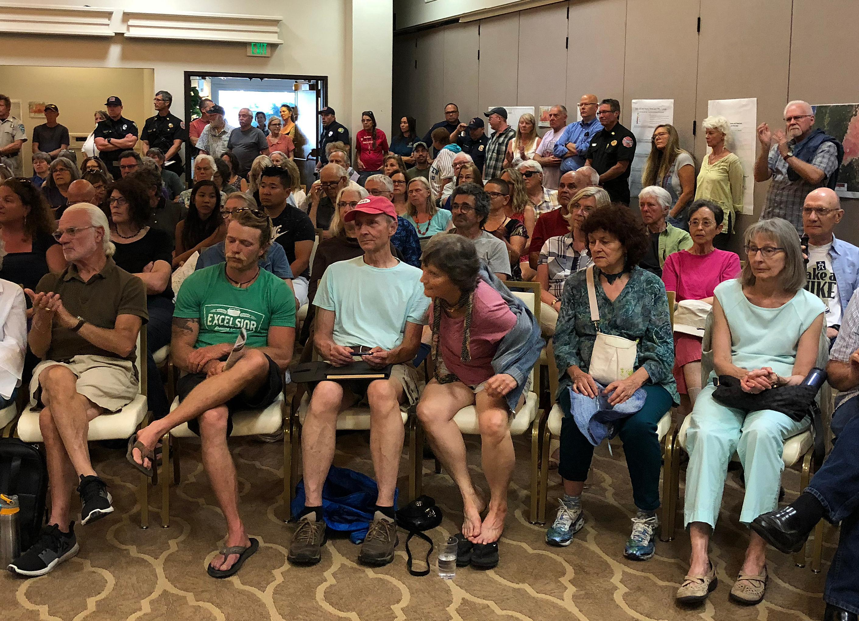 Photo by John Darling<br>A crowd packs a meeting Monday afternoon at the Ashland Hills Hotel called on short notice by agencies cooperating on fighting the Klamathon Fire.