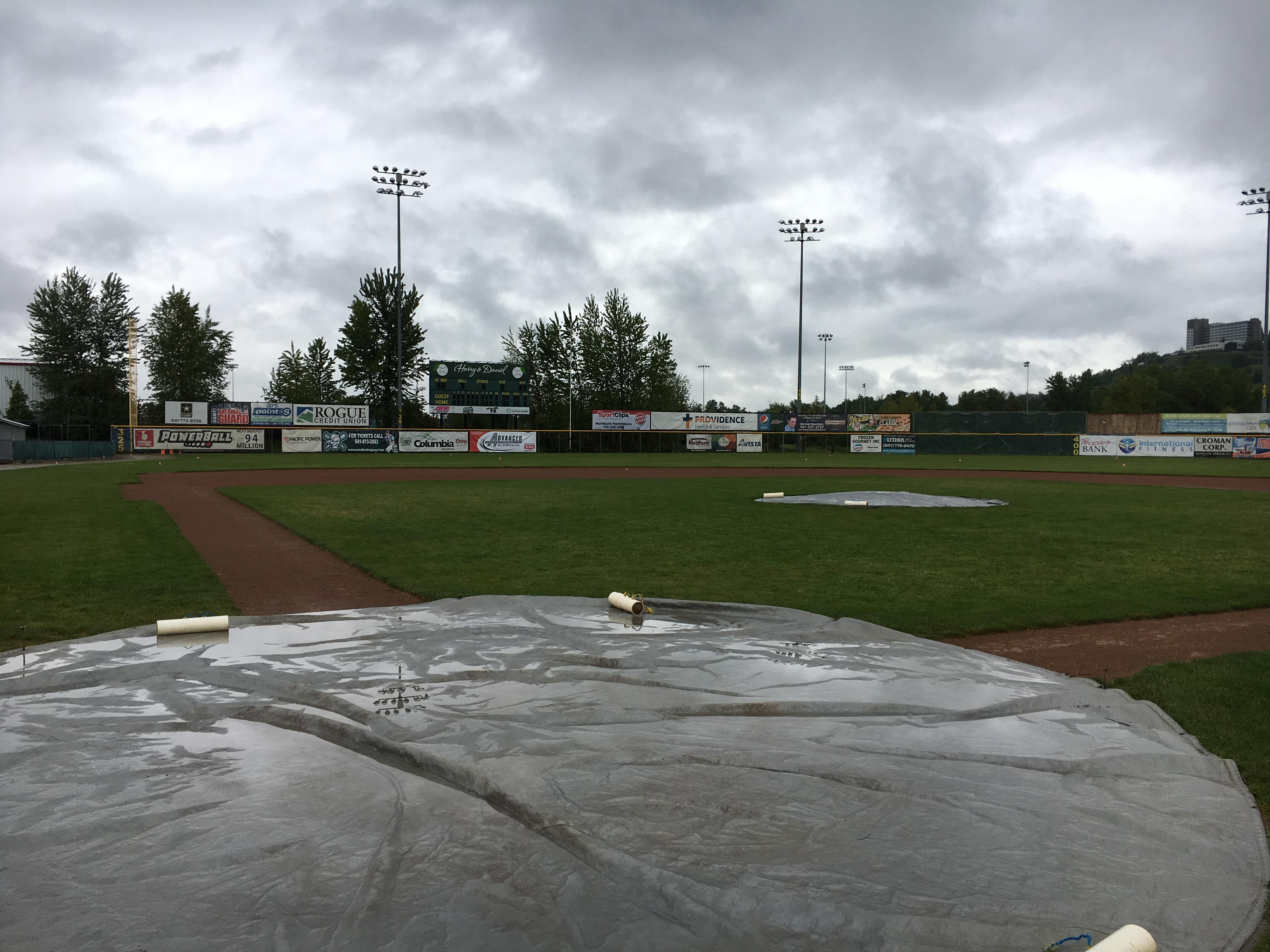 Rain falling on Harry & David Field with the Rogues set to open May 30th. (KTVL/Aaron Nilsson)