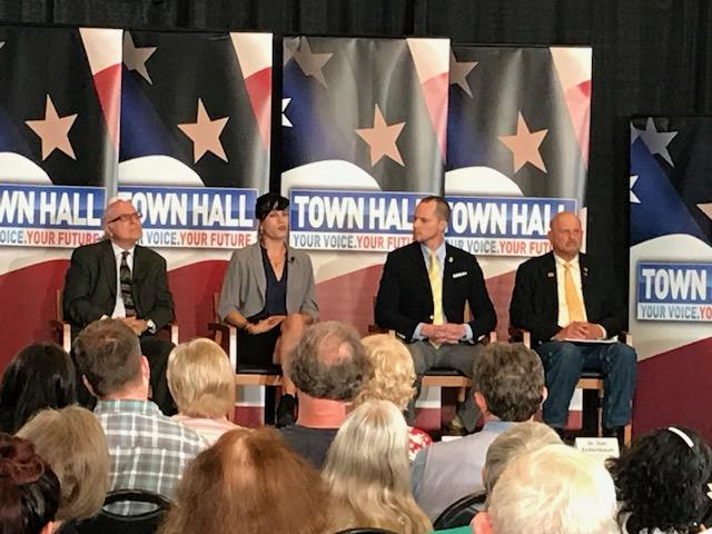 Town Hall panelists from left to right: Dr. George Pappas, Marisol Jimenez, Bryan Cox & Dr. Dan Eichenbaum. (Photo credit: WLOS Staff)