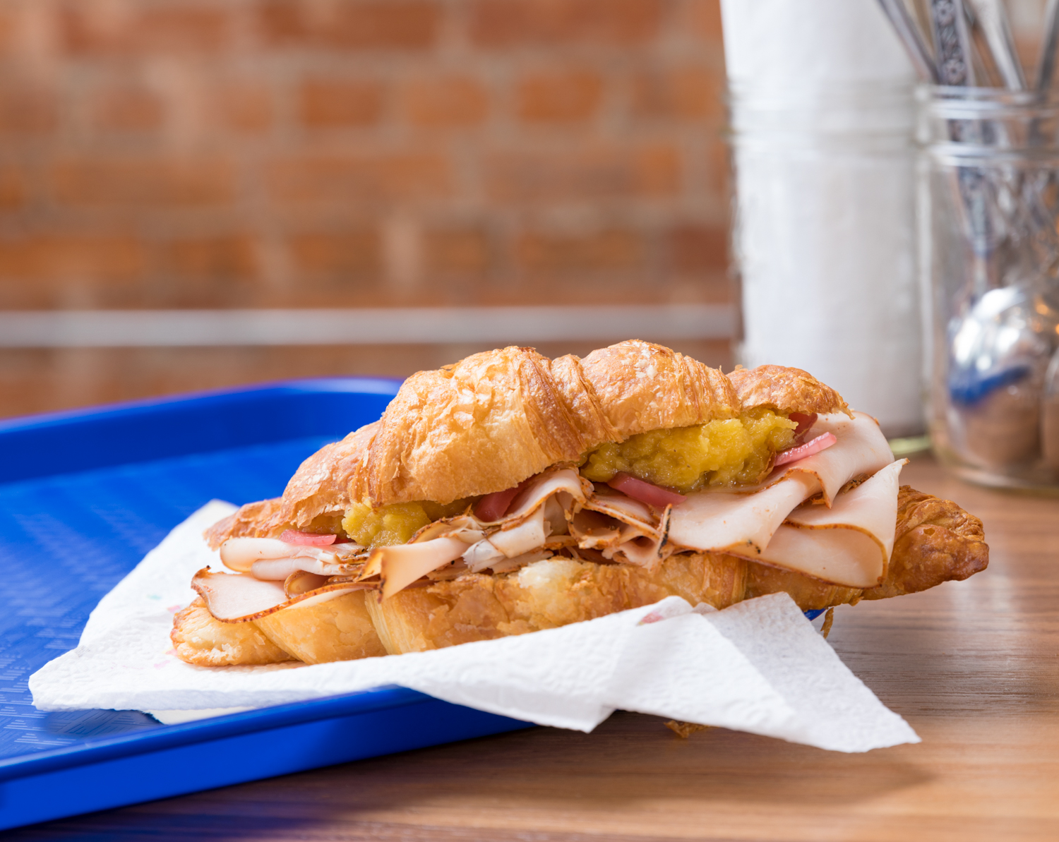 Turkey sandwich with pickled onions on croissant with squash mash{ }/ Image: Marlene Rounds // Published: 3.12.19