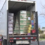 Semi-truck delivers 31,000 boxes of Girl Scout cookies to be distributed to area troops