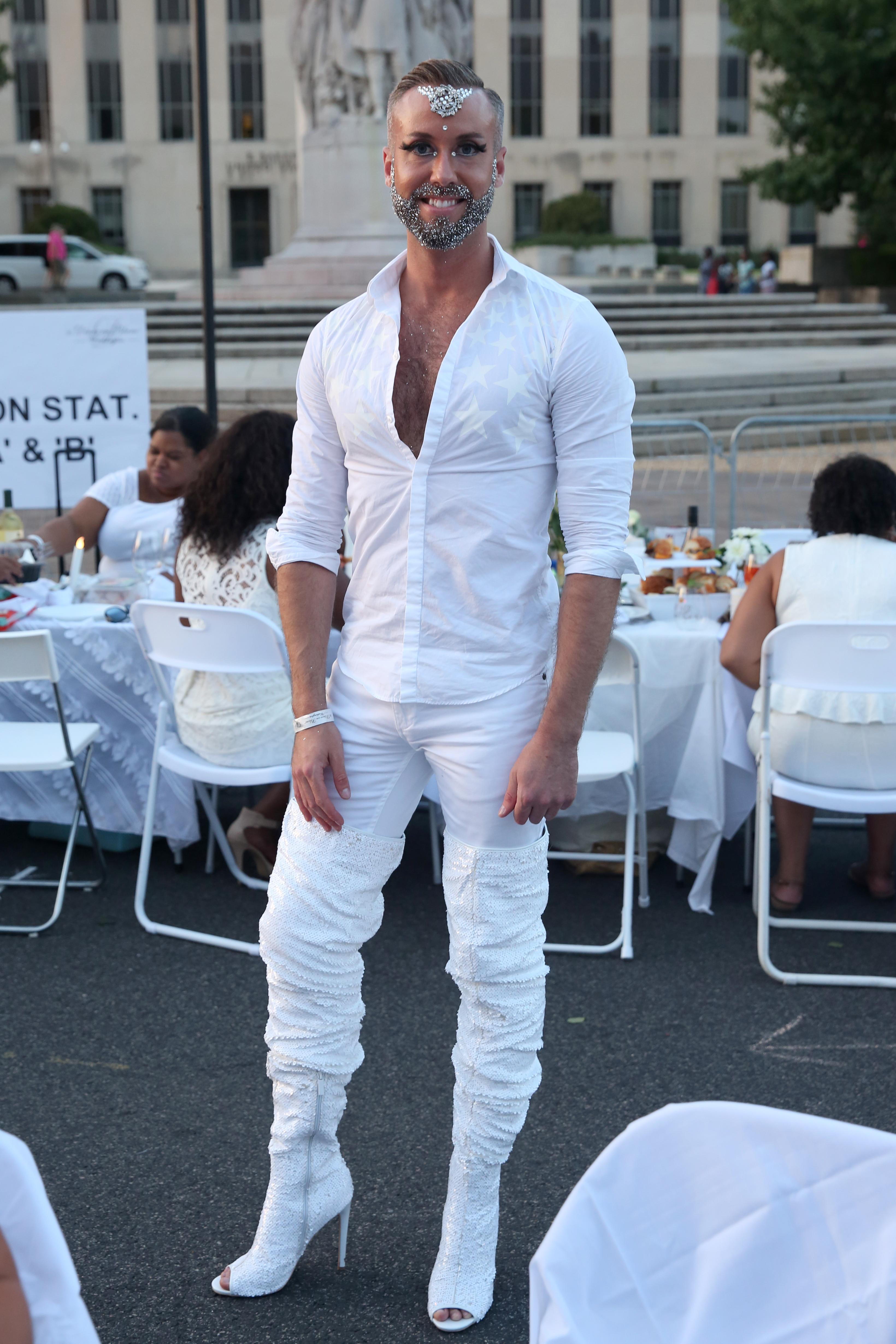 Justin McCown could was graceful and fabulous as he strutted around Diner en Blanc { }in those heels!{ }Is glitter envy a thing? Because we're pretty sure we have it!{ } (Amanda Andrade-Rhoades/DC Refined)