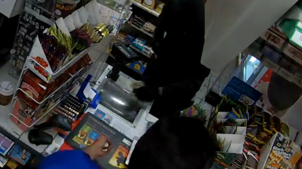 Surveillance video captures armed gas station robbery in