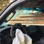 Renton driver escapes as boards fly through windshield