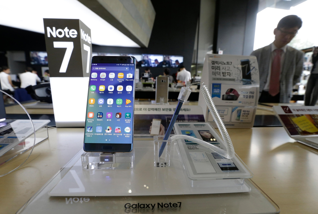 In this Sept. 8, 2016 photo, a Samsung Electronics' Galaxy Note 7 smartphone is displayed at the headquarters of South Korean mobile carrier KT in Seoul, South Korea. (AP Photo/Ahn Young-joon)