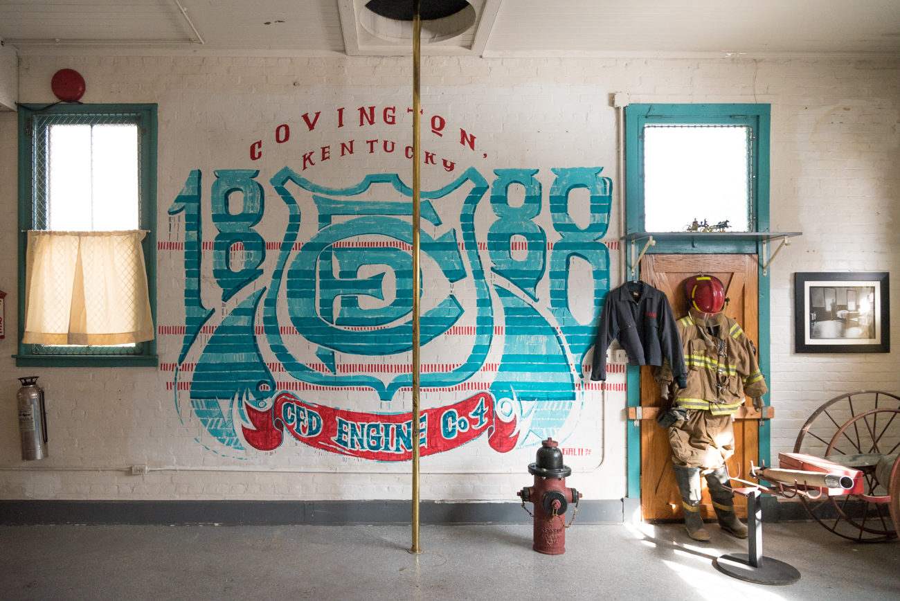 The first floor, where the fire engine once sat, is now a massive garage with laundry machines for the residents in the rear. It is currently outfitted with firefighter memorabilia. ADDRESS: 827 Main St, Covington, KY 41011 / Image: Phil Armstrong, Cincinnati Refined // Published: 3.23.17