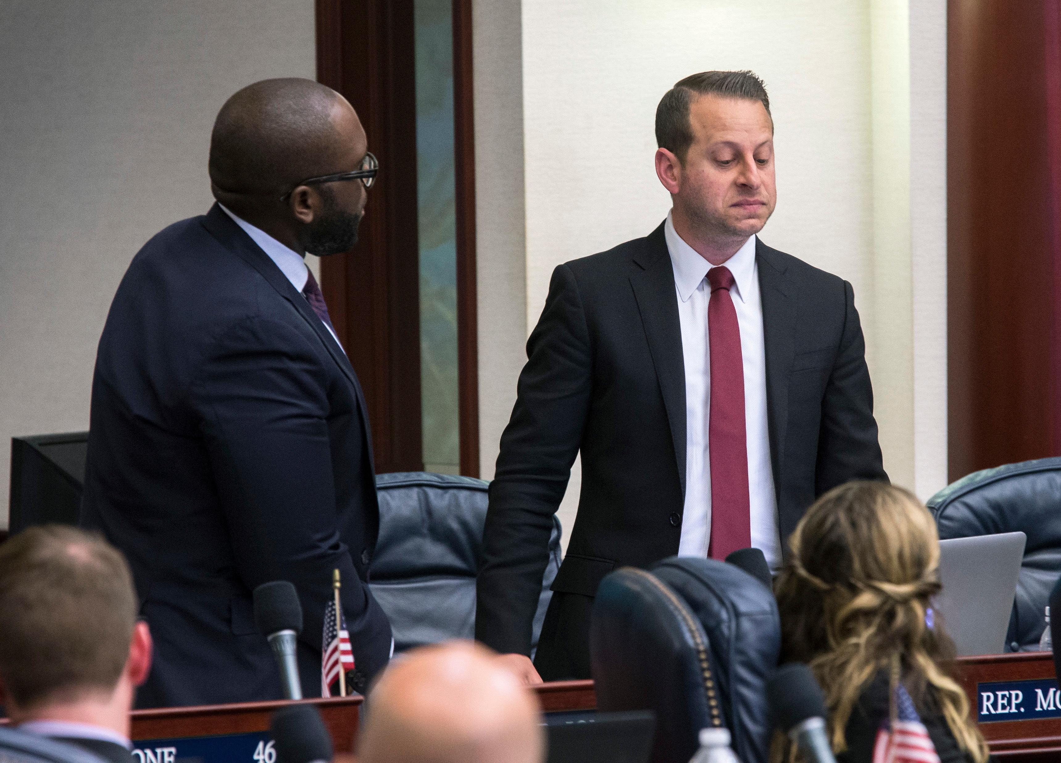 Florida Rep. Jared Moskowitz, right, D-Coral Springs, regains his composure during his debate of the school safety bill as Rep. Shevrin D. Jones, D-West Park, looks on just prior to the vote at the Florida Capital in Tallahassee, Fla., Wednesday March 7, 2018. (AP Photo/Mark Wallheiser)