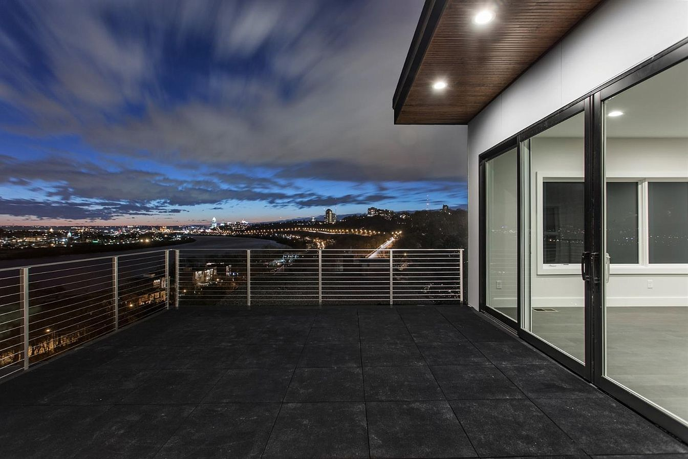 430 Whitman Court in Hyde Park - $1,375,000 / This LEED Platinum-certified custom home has four bedrooms, three and a half bathrooms, and spans 3,200 square feet. Its modern design utilizes walls of massive windows to blend the inside with nature outside, with a view of the Ohio River and the city in the distance. Also, there's room to add an elevator if you want! / Our favorite feature: It has two spacious decks overlooking the river below, which is an abundance of luxuries if you ask us! / Image: Lisa VonLuehrte of LiVon Photography // Published: 1.9.20