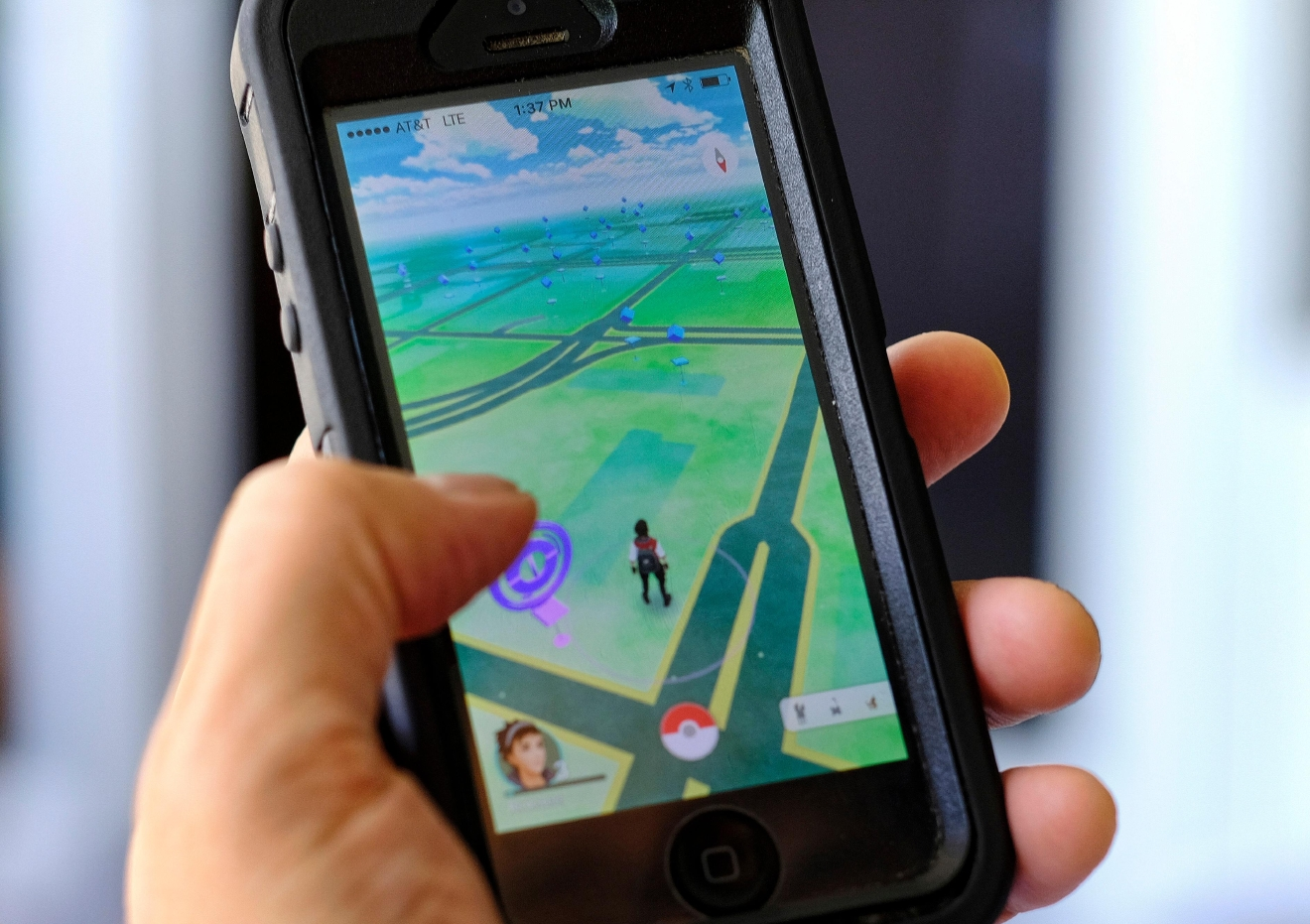 Pokemon Go is displayed on a cell phone in Los Angeles on Friday, July 8, 2016. Just days after being made available in the U.S., the mobile game Pokemon Go has jumped to become the top-grossing app in the App Store.  (AP Photo/Richard Vogel)