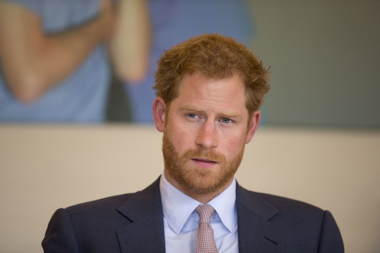 Britain's Prince Harry takes part in a round table discussion with HIV doctors at King's College Hospital in south London, Thursday, July 7, 2016, as part of his desire to learn more and raise public awareness in the fight against HIV and AIDS both internationally and in the UK. In the coming weeks Harry will meet with staff at a London sexual health clinic to see their work first-hand and also travel to Durban, South Africa to speak at the World AIDS conference. (AP Photo/Matt Dunham, Pool)