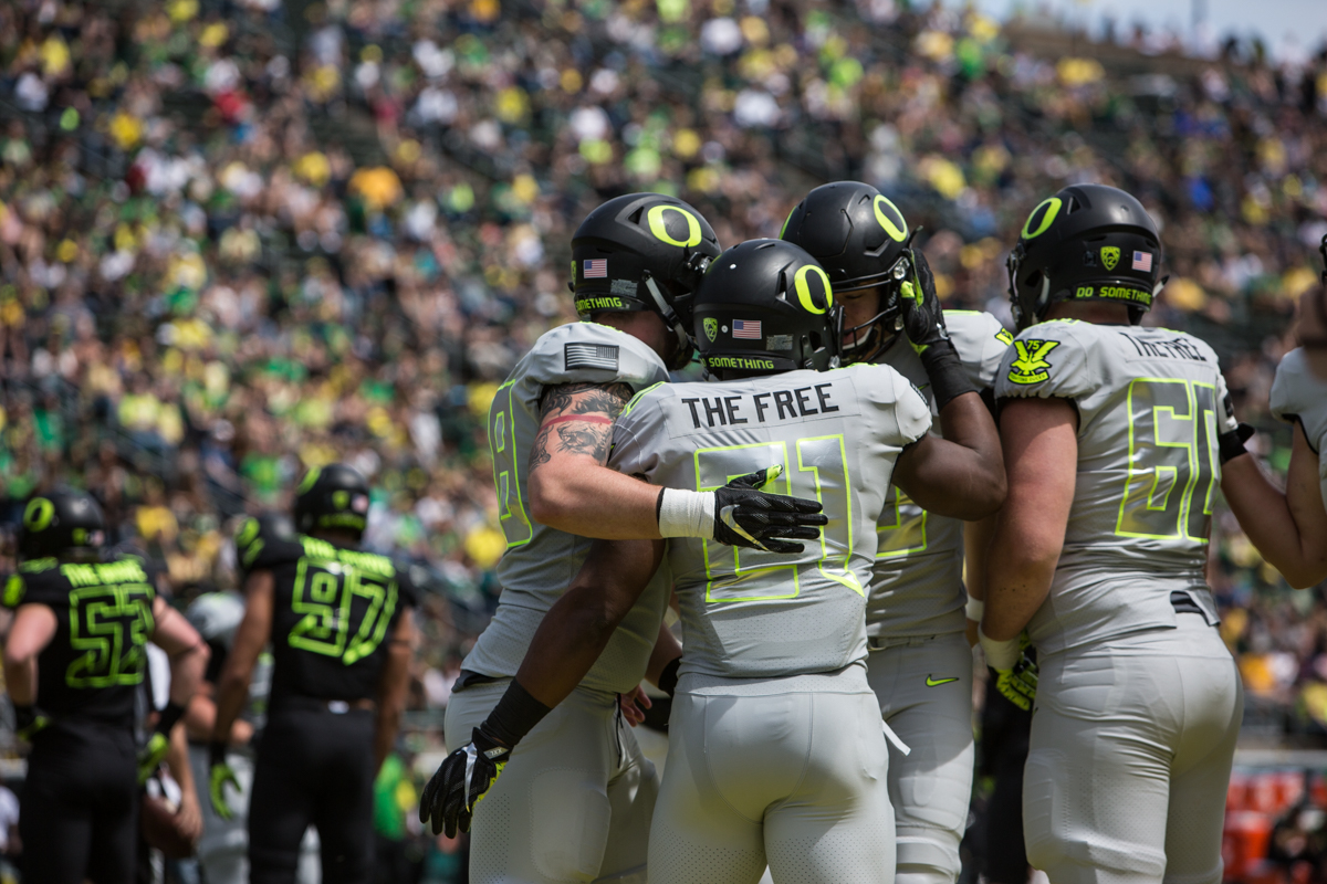 Team Free celebrates after a touchdown. The 2017 Oregon Ducks Spring Game provided fans their first look at the team under new Head Coach Willie Taggart's direction.  Team Free defeated Team Brave 34-11 on a sunny day at Autzen Stadium in Eugene, Oregon.  Photo by Austin Hicks, Oregon News Lab