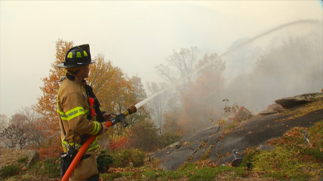 A firefighter fighting the blaze when the fire was still only 19 percent contained, and had burned 5714 acres. (Photo credit: WLOS Staff)<p></p>
