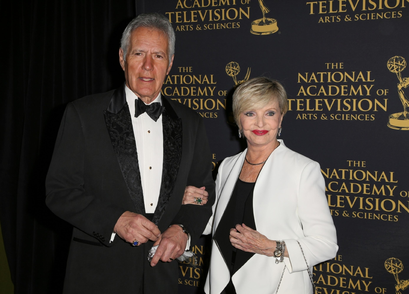 "FILE - In this April 24, 2015 file photo, Alex Trebek, left, and Florence Henderson arrive at the 2015 Daytime Creative Arts Emmy Awards at The Universal Hilton in Universal City, Calif. Henderson, the wholesome actress who went from Broadway star to television icon when she became Carol Brady, the ever-cheerful mom residing over ""The Brady Bunch,"" has died at age 82. She died surrounded by family and friends, her manager, Kayla Pressman, said in a statement late Thursday, Nov. 24, 2016. (Photo by Rich Fury/Invision/AP, File)"