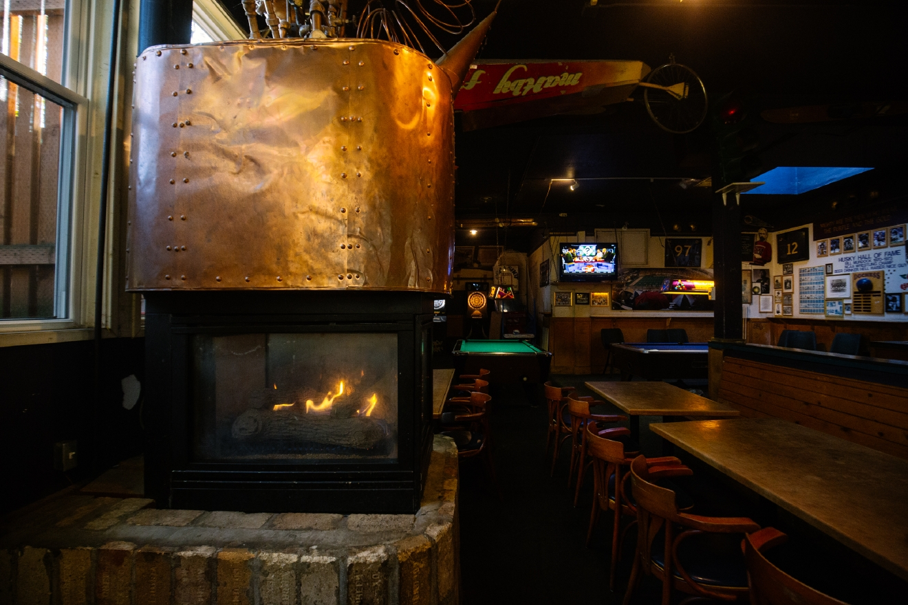 The Duchess is a small but mighty tavern, located at 2827 NE 55th St, Seattle, WA 98105.   Brrr! We're hitting some real cold temps out there people. If you don't have a fireplace at home, hop on over to one of these bars and get warm (inside and out)! (Image: Joshua Lewis / Seattle Refined)