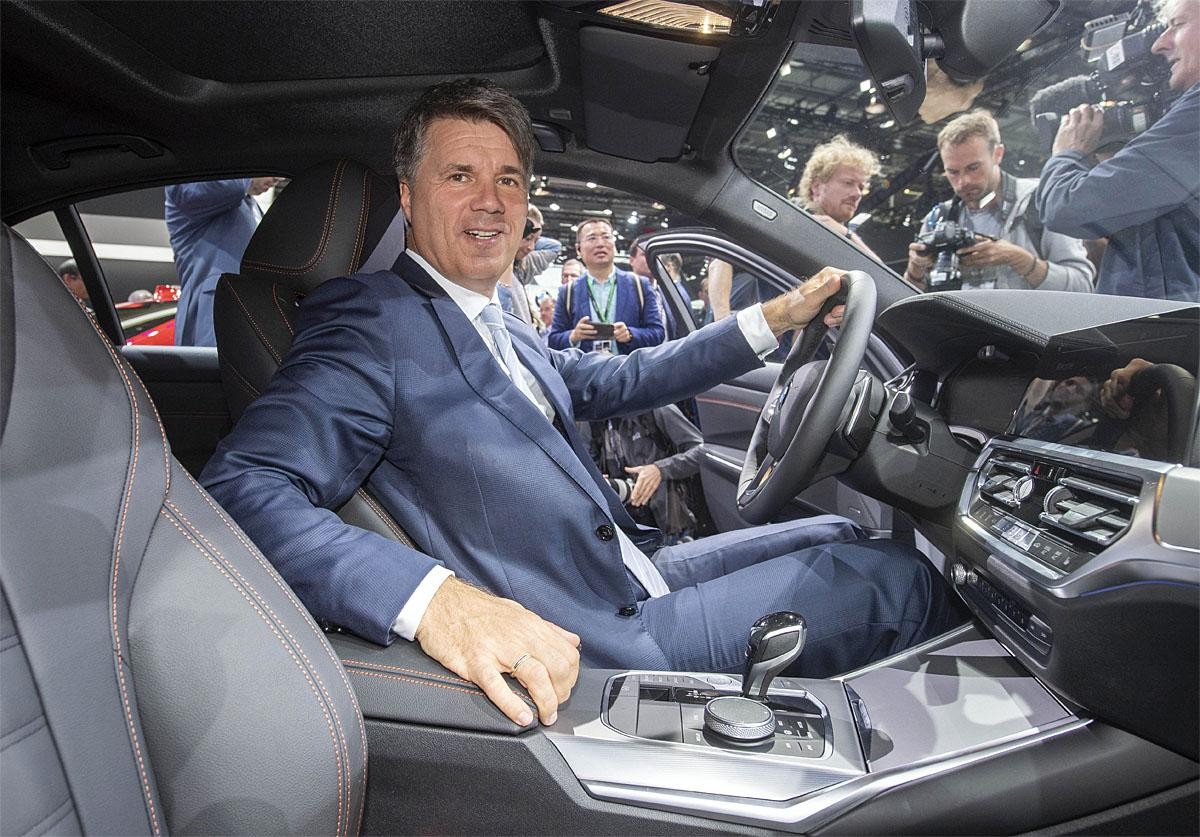 02 October 2018, France, Paris: Harald Krüger, Chairman of the Board of Management of BMW, sits on the 1st press day at the Paris International Motor Show in a new BMW 3 Series, which was presented there. From 02.10. to 03.10.2018 the press days will take place at the Paris Motor Show. It will then be open to the public from 04.10. to 14. October. Photo: Uli Deck/dpaWhere: Paris, Île-de-France, FranceWhen: 02 Oct 2018Credit: Uli Deck/picture-alliance/Cover Images