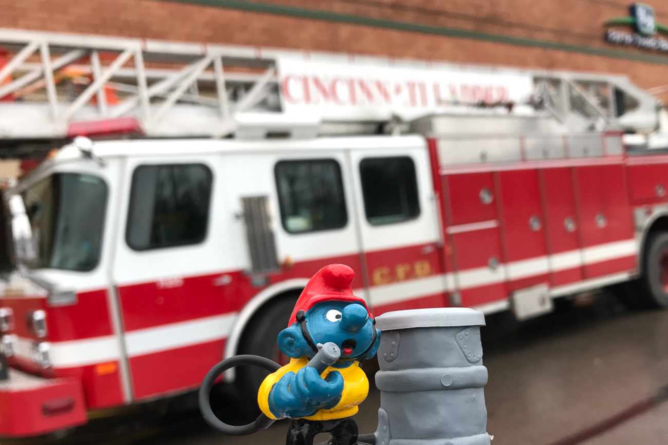 Oh Smurf / Kristian Geer uses forced perspective photography (not Photoshop) to inject surreal elements–that is, toys–into every day scenes to alter their significance. Pulling from an infinite well of imagination, his creativity paints the Queen City as a technicolor dreamscape for a cast of fictional characters interacting with our real world. / Image: Kristian Geer // Published: 8.29.18
