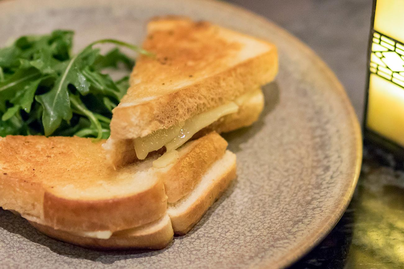 Grilled cheese: tallegio, white cheddar, honey, and an arugula salad / Image: Allison McAdams // Published: 1.31.18<p></p>