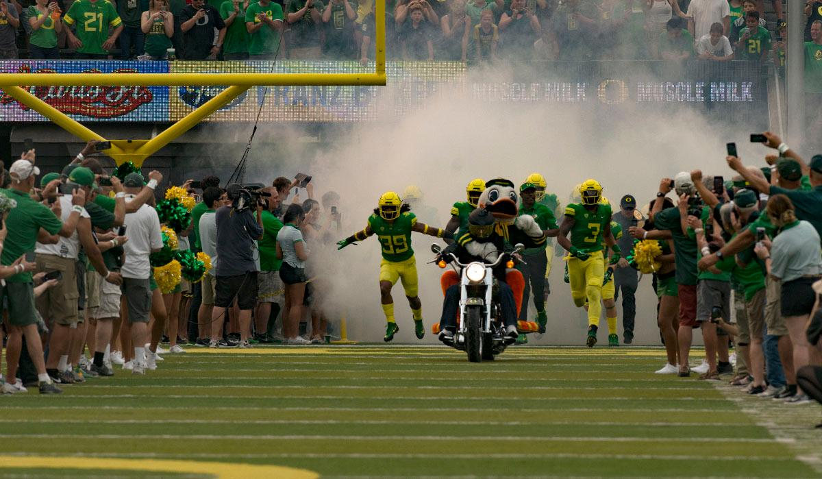 The Duck atop a motorcycle leads the Oregon Ducks onto the field.The Oregon Ducks lead the Southern Utah Thunderbirds 42 to 21 at the end of the first half of the Ducks' 2017 season opener. Photo by Ben Lonergan, Oregon News Lab