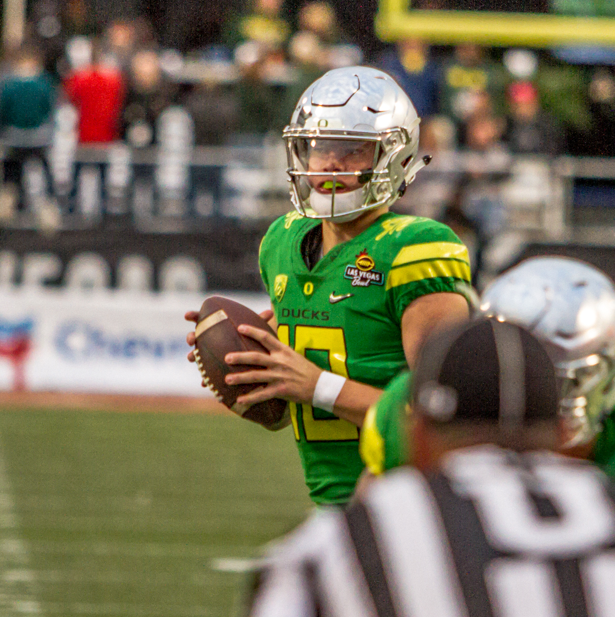 Oregon quarterback Justin Herbert (#10) looks for an open receiver down field. The Boise State Broncos defeated the Oregon Ducks 38 to 28 in the 2017 Las Vegas Bowl at Sam Boyd Stadium in Las Vegas, Nevada on Saturday December 17, 2017. The Las Vegas Bowl served as the first test for Oregon's new Head Coach Mario Cristobal following the loss of former Head Coach Willie Taggart to Florida State University earlier this month. Photo by Ben Lonergan, Oregon News Lab