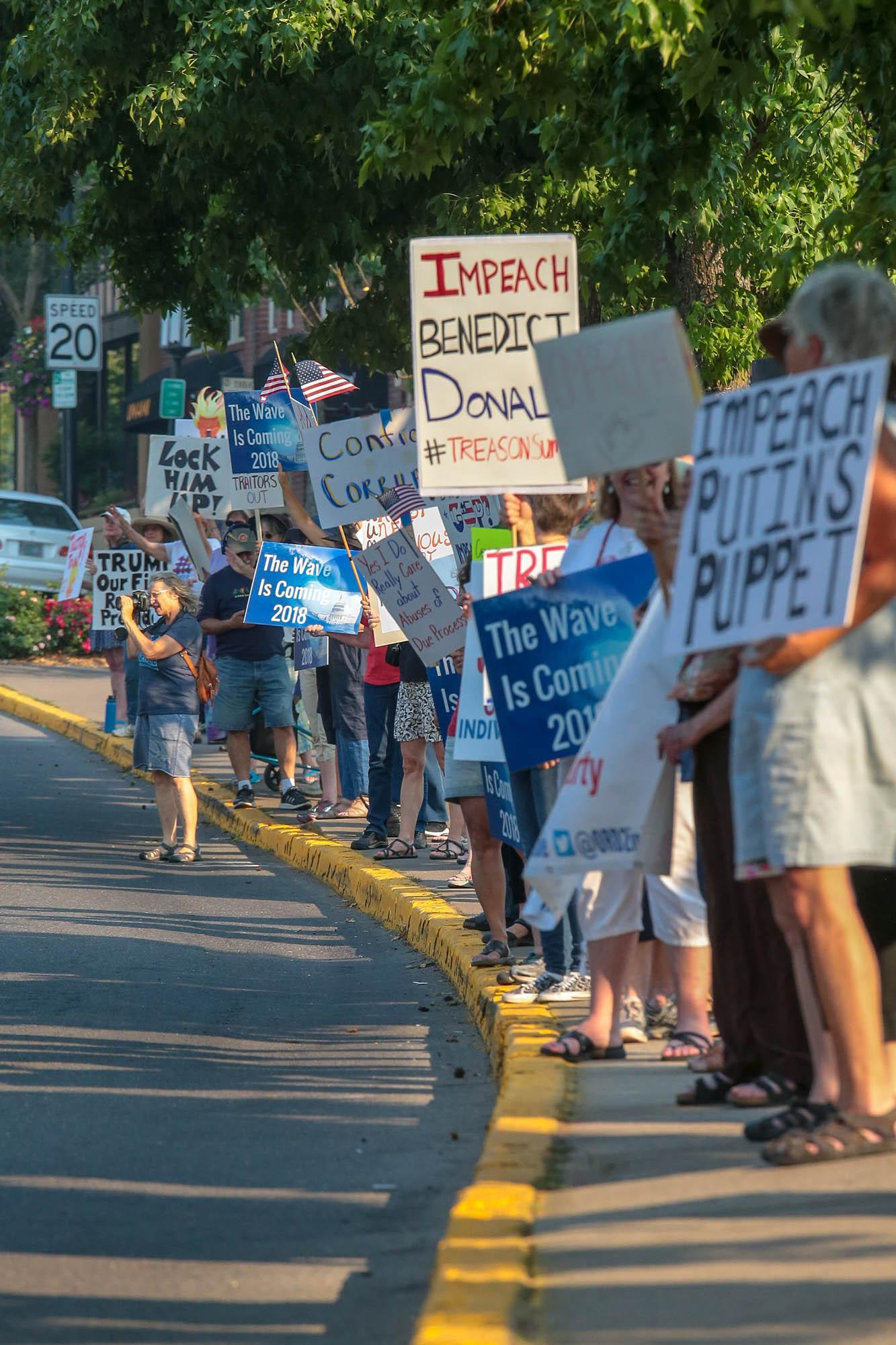 Photo by Larry Stauth Jr.Area residents gather Wednesday along Main Street in Ashland to protest President Donald Trump.