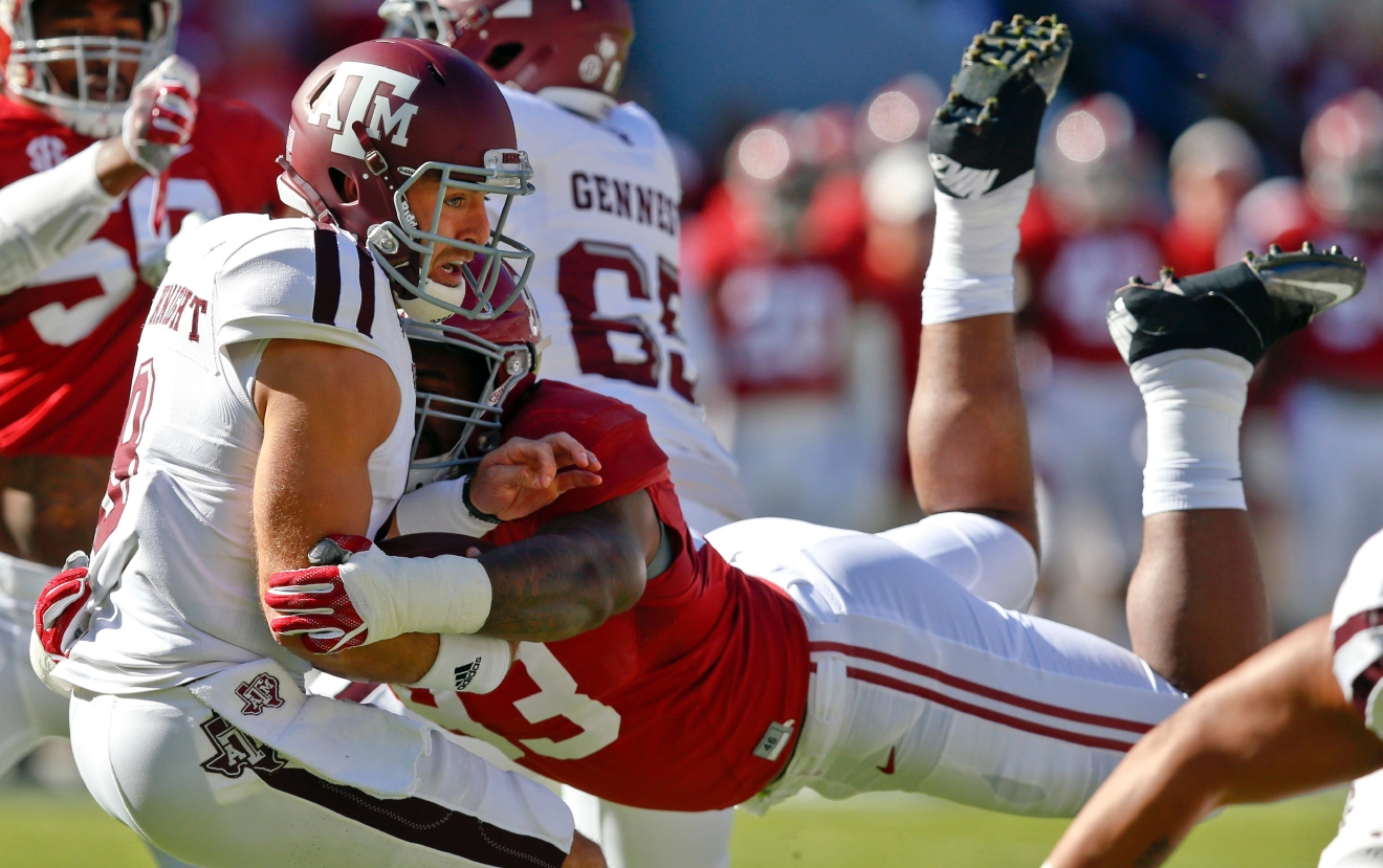 FILE - In this Oct. 22, 2016, file photo, Alabama defensive lineman Jonathan Allen (93) sacks Texas A&M quarterback Trevor Knight during the first half of an NCAA college football game, in Tuscaloosa, Ala. Allen was selected to the 2016 AP All-America college football team, Monday, Dec. 12, 2016. (AP Photo/Brynn Anderson, File)