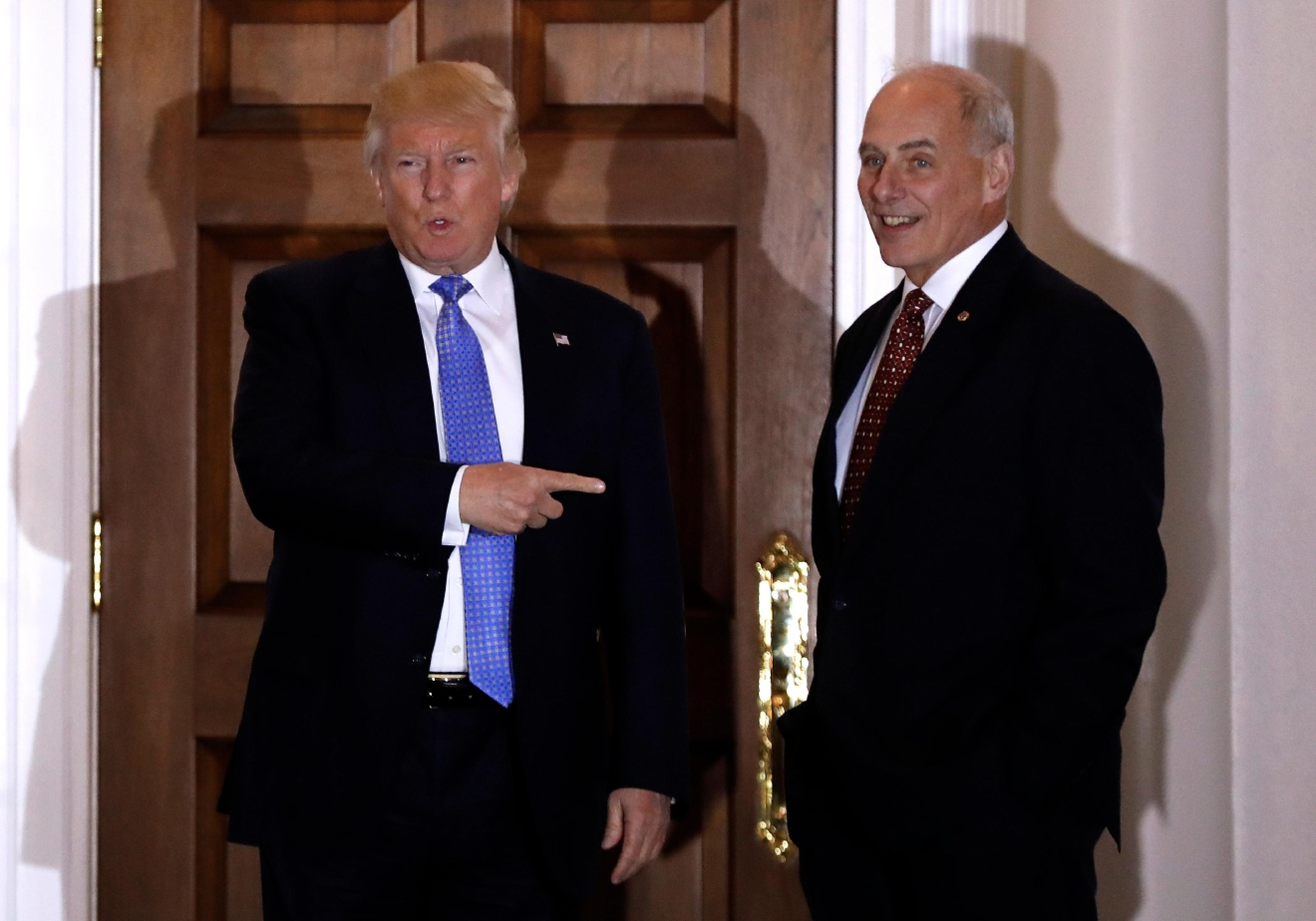 FILE - In this Nov. 20, 2016 file photo, President-elect Donald Trump talks to media as he stands with  retired Marine Gen. John Kelly at the Trump National Golf Club Bedminster clubhouse in Bedminster, N.J. Kelly is likely to be pressed about plans to build a border wall and other steps to boost immigration security at a Senate confirmation hearing on Jan. 10, for President-elect Donald Trump's pick for Homeland Security secretary. (AP Photo/Carolyn Kaster, File)