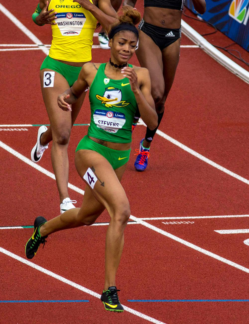 Oregon�s Deajah Stevens crosses the finish line of the Women�s 200m Dash. Stevens finished second with a time of 22.30. Day 10 of the U.S. Track and Field Trials concluded Sunday at Hayward Field in Eugene, Ore. The competition lasted July 1 through July 10. Photo by Amanda Butt