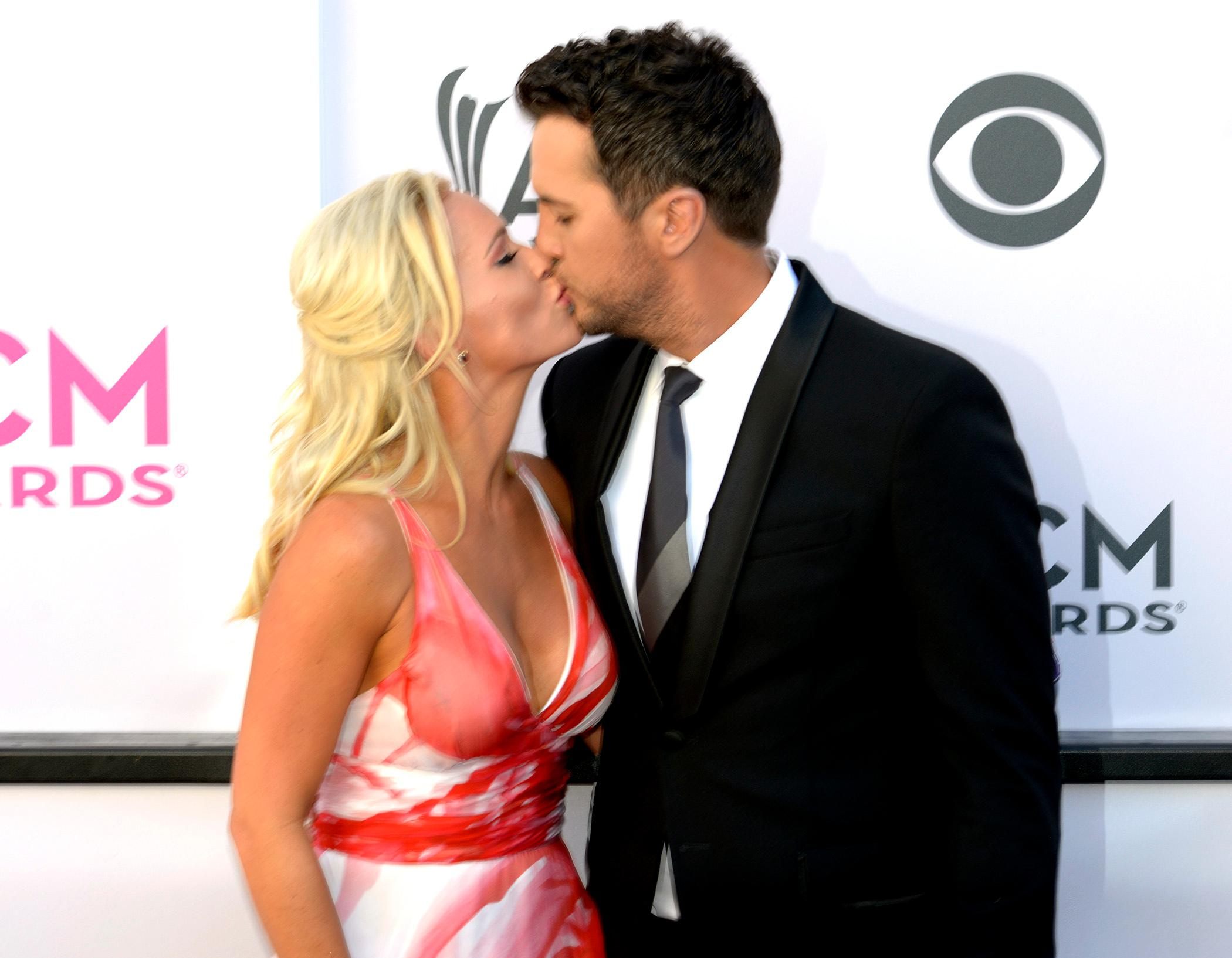 Spring is in the air as Luke Bryan host and nominee for Performer Entertainer of the Year at the Academy of Country Music Awards kisses wife Caroline Boyer on the red carpet at T-Mobile Arena. Sunday, April 2, 2017. (Glenn Pinkerton/ Las Vegas News Bureau)