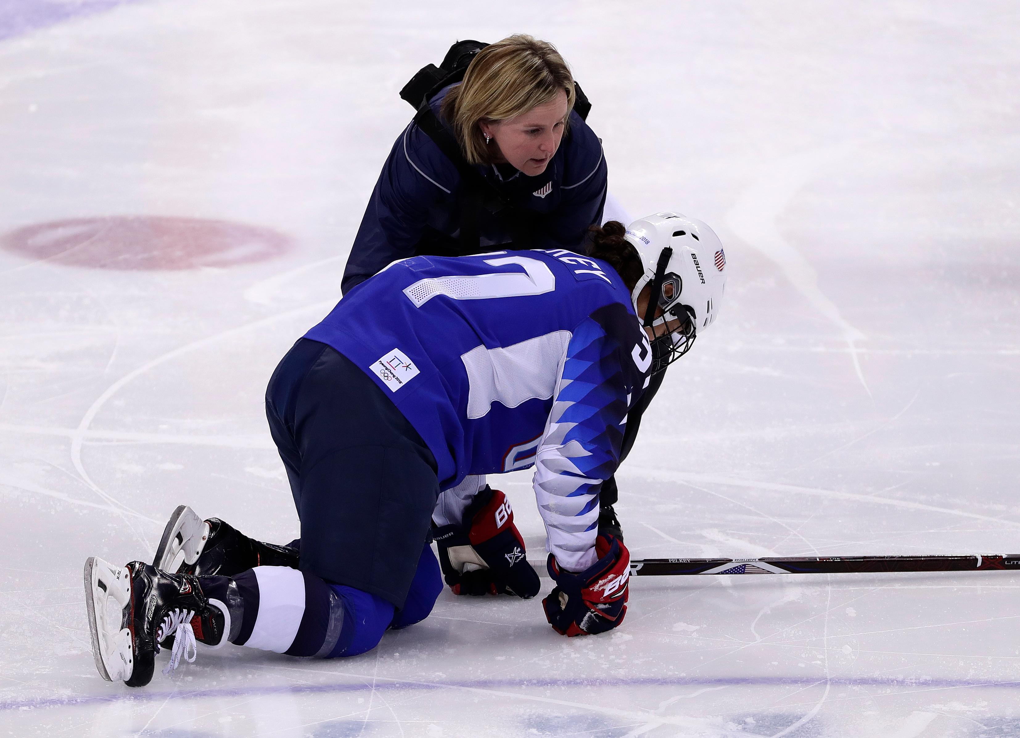 Amanda Pelkey, of the United States, is checked by team doctor Ally Howe during the first period of the preliminary round of the women's hockey game against the team from Russia at the 2018 Winter Olympics in Gangneung, South Korea, Tuesday, Feb. 13, 2018. (AP Photo/Frank Franklin II)