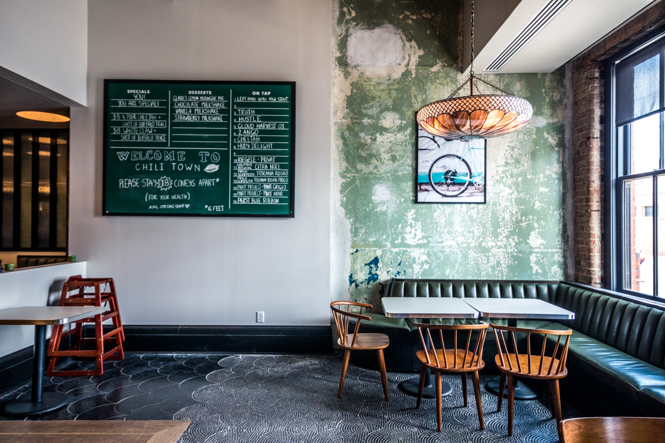 "OTR Chili, which shares the building with Rhinegeist Brewery, is the first dedicated chili parlor to open in Over-the-Rhine in decades. ""Chili Town,"" as they've coined themselves, welcomes anyone craving Cincinnati-style chili in addition to items like burgers, shakes, beer, wine, cocktails, and specials that change daily. Vegetarian chili and a variety of salads are available. ADDRESS: 1910 Elm Street (45202) / Image: Catherine Viox // Published: 6.29.20"