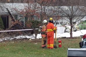 Firefighters look over damage after plane crashes into house in Gaithersburg, Md. (Photo: Brad Bell/WJLA)