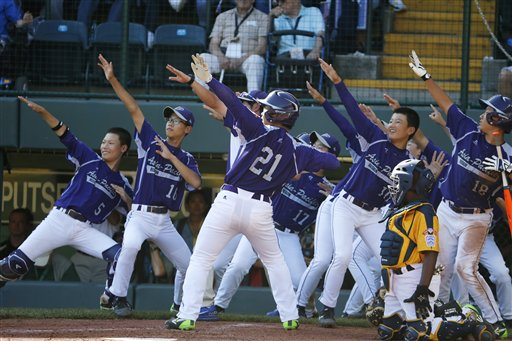 South Korea's Hae Chan Choi (21) celebrates with teammates after hitting a two-run home run off Chicago's Brandon Green in the sixth inning of the Little League World Series championship baseball game.