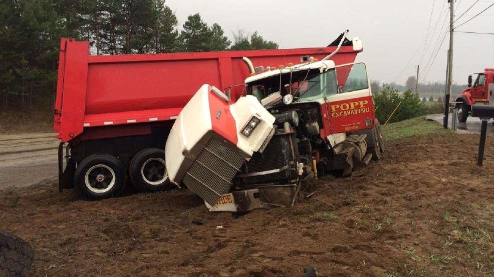 Dump Truck Crashes Into Car