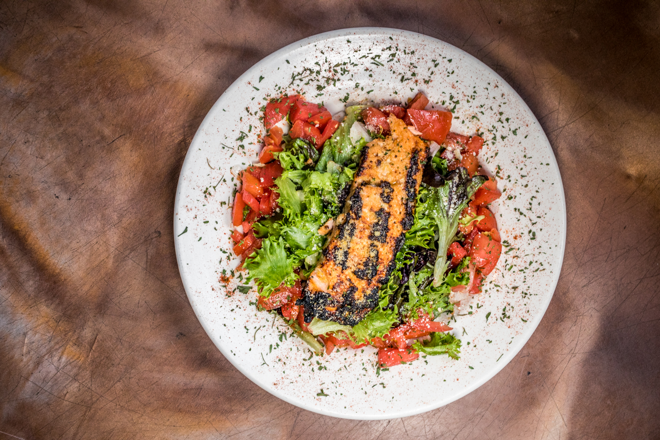 Grilled Salmon Salad with tomatoes and crusted in parmesan cheese / Image: Catherine Viox{ }// Published: 8.10.20