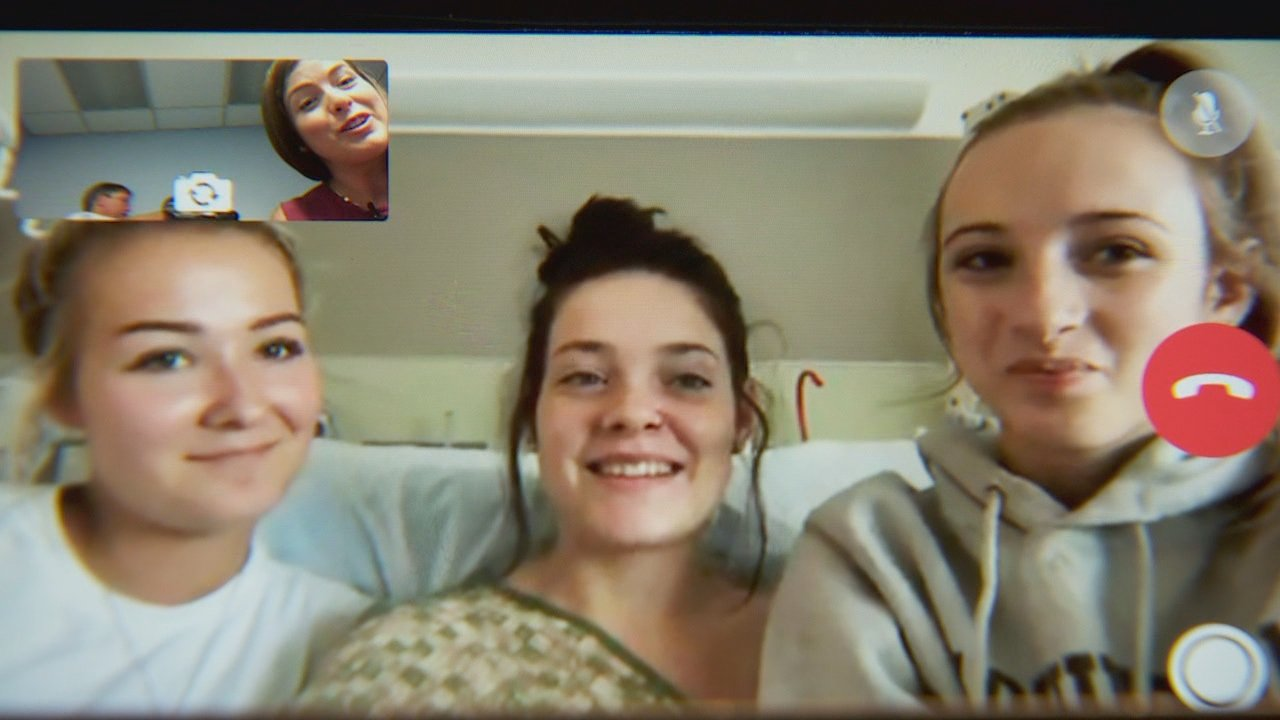 Jordan Holgerson, center, speaks from the hospital where she's recovering from five broken ribs and an injured lung. She suffered injuries after she was pushed off a bridge near Moulton Falls. KATU photo{ }