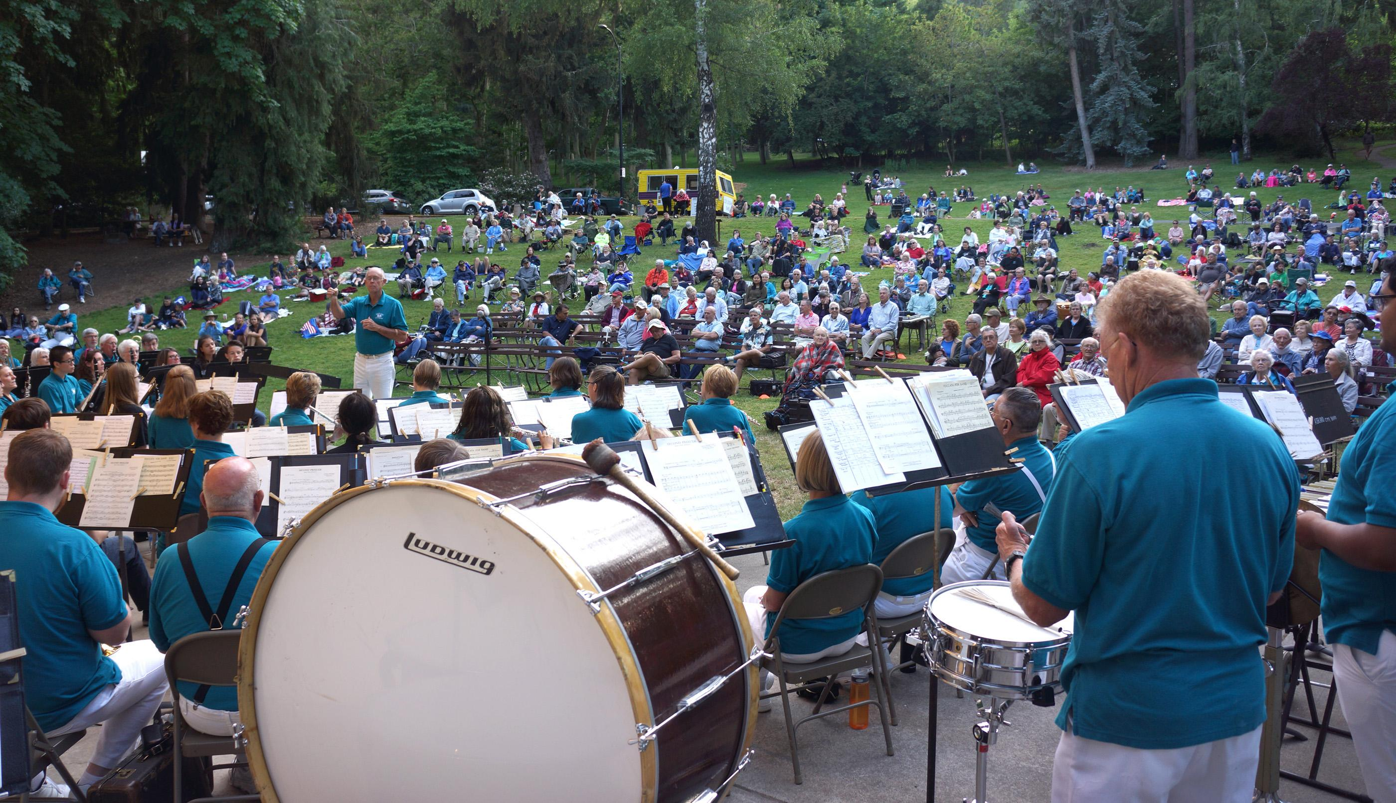 A big crowd enjoys the Ashland City Band perform at the Butler Bandshell in Lithia Park. (Photo by Jim Flint)