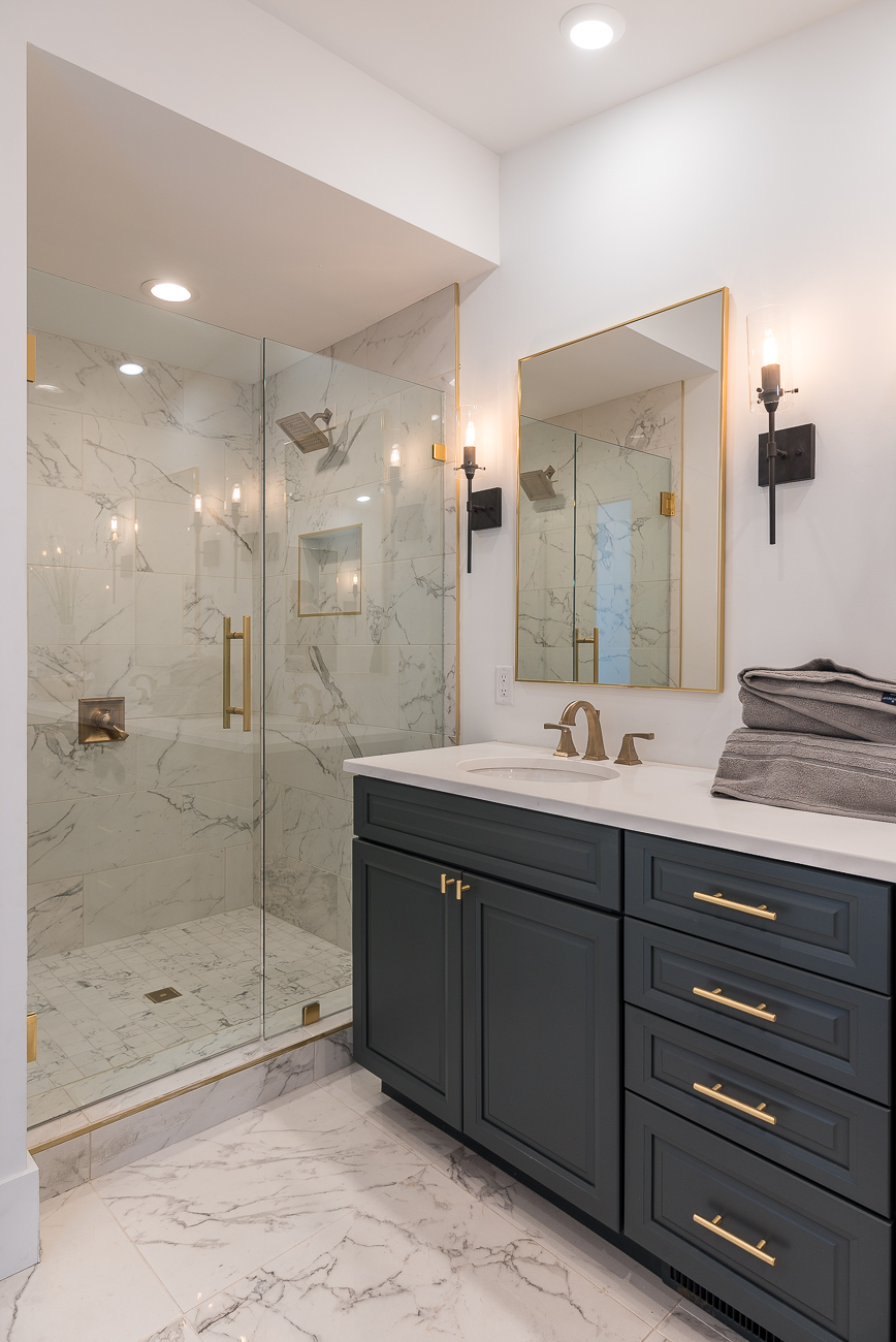 The master bathroom shower has dual shower heads (the other one is obscured by the wall in this photo). Not pictured: the toilet behind a closed door. / Image: Phil Armstrong, Cincinnati Refined // Published: 2.4.19
