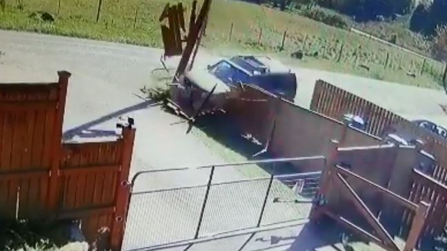 Watch: Distracted driver crashes through two fences and a power pole
