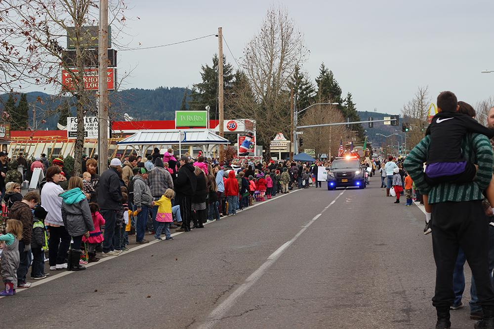 Thousands line the street and wait for the 63rd Annual Sprigfield Christmas Parade to start Saturday, Dec. 5, in Springfield, Ore. Photo by Claire Aubin.